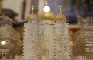 A model of a Russian Orthodox church and spiritual centre is seen during a media presentation at the Russian ambassador's residence in Paris