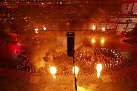 Performers take part in the opening ceremony of the London 2012 Olympic Games at the Olympic Stadium