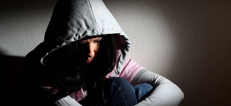 Upset girl in hood