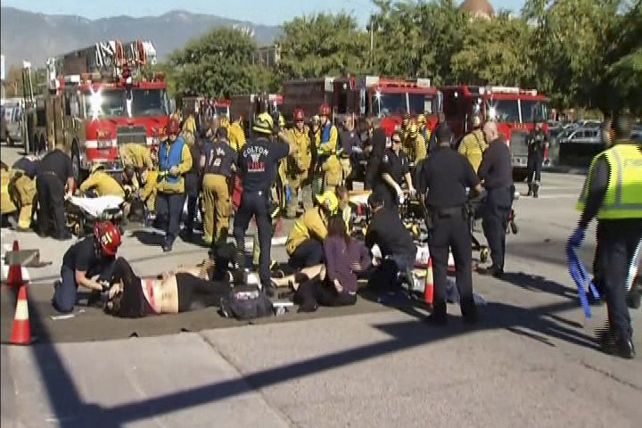 Still from video shows rescue crews tending to the injured in the intersection outside the Inland Regional Center in San Bernardino