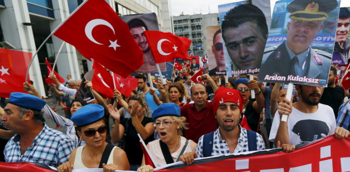 Demonstrators, wearing commando berets and holding pictures of the late Turkish army members who were killed by Kurdish militants, shout nationalist slogans during a protest against recent attacks on Turkish soldiers, in Istanbul, Turkey, September 7, 2015. Turkish warplanes bombed Kurdish insurgent targets overnight after the militants staged what appeared to be their deadliest attack since the collapse of a two-year-old ceasefire in July and killed 16 government soldiers. The military said its aircraft bombed 23 targets in a mountainous area near the Iraqi frontier on Monday. Another six soldiers had been wounded, but none were in critical condition. REUTERS/Murad Sezer - RTX1RIO1